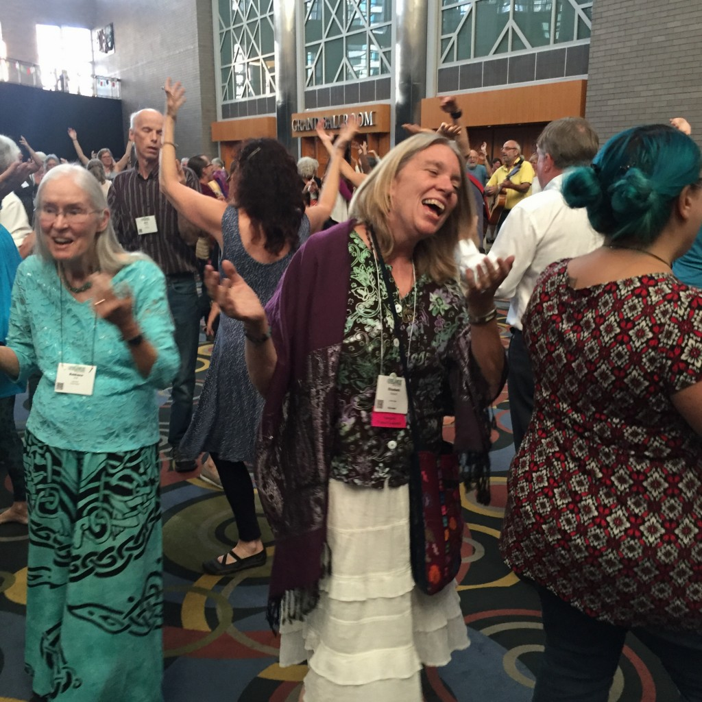 BI/NK President Elizabeth Dequine with Dances of Universal Peace at the Parliament.