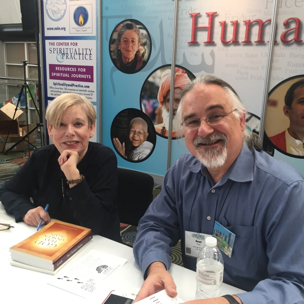 BI/NK member Reed Price assists religion scholar Karen Armstrong at a book signing.