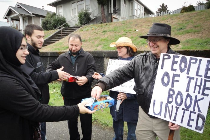 Zainab Haji (left) gives cookies to Kent Chadwick, who turned out in support of the Islamic Center of Kitsap County. Despite plans for an anti-Islam rally the Bremerton mosque, no protesters actually showed. (Photo courtesy CAIR-WA)